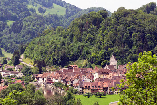 The village of Saint-Ursanne by the River Doubs in Switzerland's Jura Canton (photo © hidden europe).