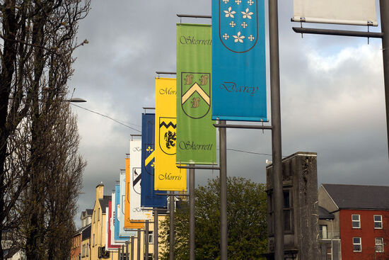 The ceremonial banners of Galway's leading mercantile families (the 'tribes') are displayed in Eyre Square (photo © hidden europe).