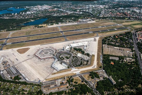 Berlin's Tegel Airport from the air in summer 2020. The classic open hexagon terminal is at the top left of the airport complex. Note the taxiway which runs over the top of the main approach road (photo © Mariohagen / dreamstime.com).