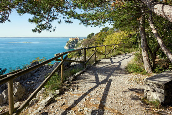 On the Sentiero Rilke (the Rilke Trail) with Duino Castle in the distance (photo Mauro Carli / dreamstime.com).
