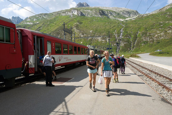 Hikers arriving at Oberalppass station, which is at an altitude of 2,033 metres in the Swiss Alps (photo © hidden europe).