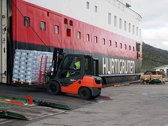 Salted cod bound for Angola being loaded onto the Hurtigruten ship MS Kong Harald at the Norwegian port of Havøysund (photo © hidden europe).