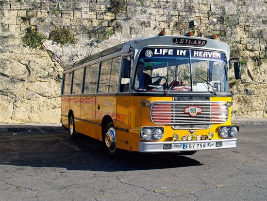 """Life in Heaven"" reads the sign on the frontof the 91 that stops and starts infierce traffic on the rush-hour run from the capitalValletta to Qormi (photo © hidden europe)."