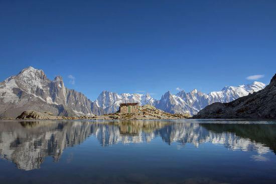 Shades of cyan around the Mont Blanc Massif, seen here reflected in Lac Blanc above Chamonix, France (photo © Bogdan / dreamstime.com).
