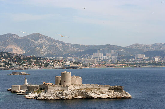 Château d'If with the city of Marseille on the mainland behind (photo © Dan Talson / dreamstime.com).
