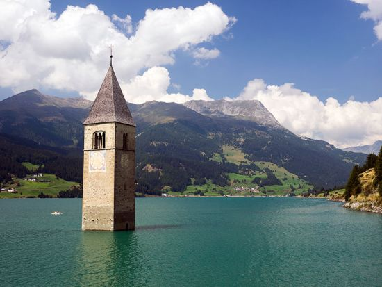This tower in Lago di Resia (Reschensee) in Italy's Alto Adige region is all that remains of the old parish church of Graun-im-Vinschgau (photo © hidden europe)