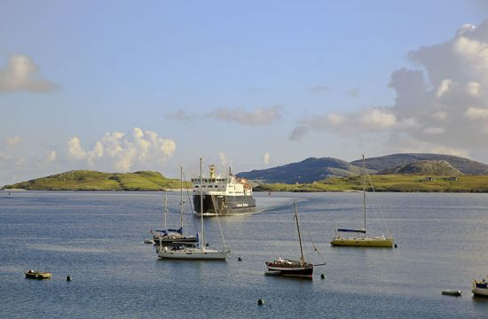 A CalMac ferry approaching the jetty in the harbour of Castlebay, Barra (photo © Donaldford / dreamstime.com).