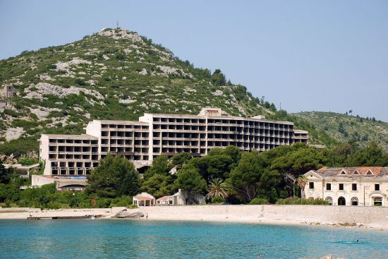 The empty shell of the Hotel Kupari, in the Croatian resort of the same name, dwarfs its predecessor, the Grand Hotel, seen at the bottom right of the picture (photo © Duncan JD Smith).