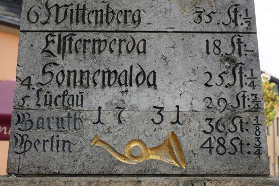 Part of a 'Kursächsische Postmeilensäule' - a milestone erected in the Electorate of Saxony as part of an initiative to formalise postage charges. This milestone is at Bad Gottleuba on the former post route between Dresden (Saxony) and Teplice (Bohemia) (photo © hidden europe).