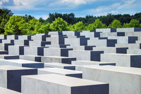 Our image shows just one portion of the Memorial to the Murdered Jews of Europe in Berlin; the wooded area in the background is the Tiergarten (photo © Matyas Rehak / dreamstime.com).