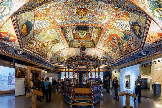 Gateway to Heaven — reconstructed elements of the Gwoździec synagogue at POLIN: Museum of the History of Polish Jews in Warsaw. The elaborate painted roof and 'bimah' (platform) are typical of the wooden synagogues of the Polish-Lithuanian Commonwealth (photo © Filip Kwiatowski).