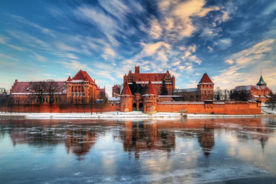 Malbork Castle with the River Nogat in the foreground. Once a fortress for the Teutonic  Order, the castle served for over 300 years as a Polish royal residence (photo © Patryk Kosmider / dreamstime.com).