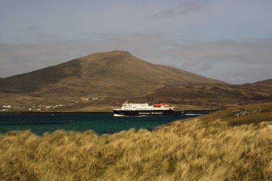 The 'MV Clansman' arriving at Castlebay on Barra in spring 2017. The vessel provides a seasonal weekly link between Barra and both Coll and Tiree. The prominent mountain is Heabhal, at 383 metres the highest elevation on Barra (photo © hidden europe).
