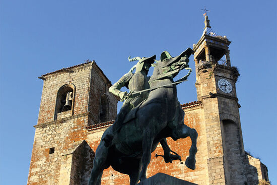 Equestrian statue of Francisco Pizarro in Trujillo's Plaza Mayor. The stork-adorned tower of the Iglesia de San Martín is in the background (photo © Laurence Mitchell).
