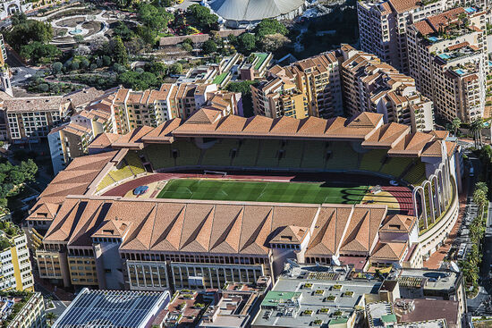 Monaco's Louis II football stadium — the line of palm trees to the right of the structure is already in France (photo © Manjik / dreamstime.com).