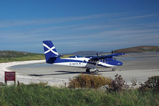 A Loganair plane in Saltire livery about to leave Barra airport. The photo was taken in 2016 and thus harks back to the time when Loganair was still a franchisee of Flybe (photo © hidden europe).
