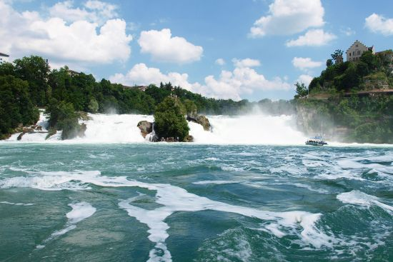 The Rhine Falls at Schaffhausen in Switzerland with Schloss Laufen on the right (photo © hidden europe).