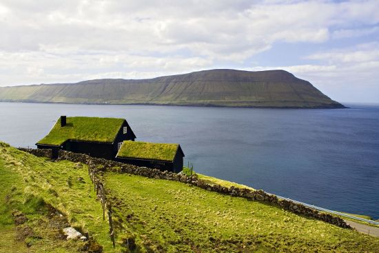 The widespread use of turf roofs makes many Faroese settlements blend imperceptibly into the landscape. Coping with a harsh environment has been an enduring ingredient of Faroese life (photo © Rastislav Vimpel / dreamstime.com).