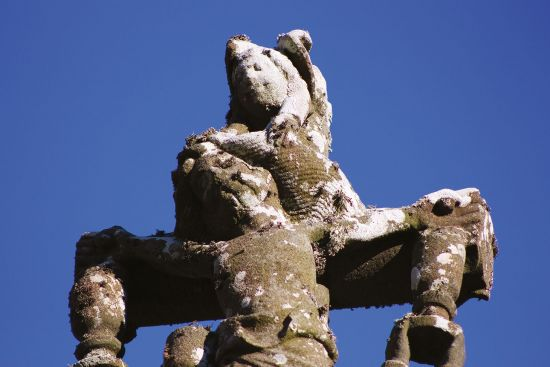 The 'ange de la tendresse' holds back Jesus' hair on the great calvary at Tronoën (photo © Patricia Stoughton).