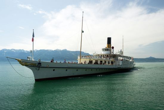 Belle époche paddle steamers ply Lake Geneva, connecting the villages along the lakeshore. Here, the historic steamer 'La Suisse' arrives at the station in Cully. The vessel has been in regular service for over 100 years (photo © hidden europe).
