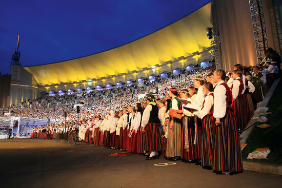 Huge choirs performing at the Latvian Festival of Song and Dance 2008 (photo © Kalvis Kalsers / dreamstime.com).