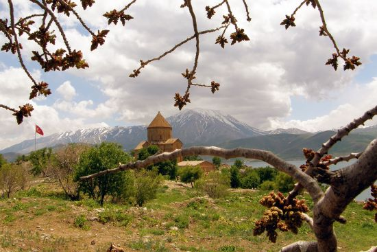 The recently restored Church of the Holy Cross on Akhtamar Island in Lake Van with the mountains of the mainland beyond (photo © Karlos Zurutuza).