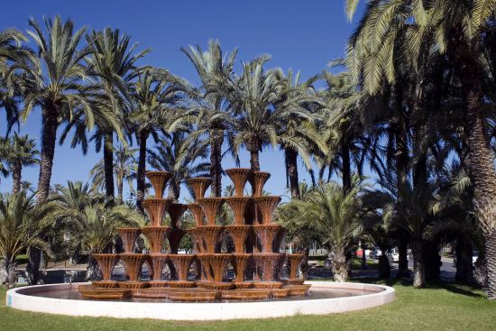 Palm trees and waterfall at Elche, Spain (photo © Martin Garnham / dreamstime.com).