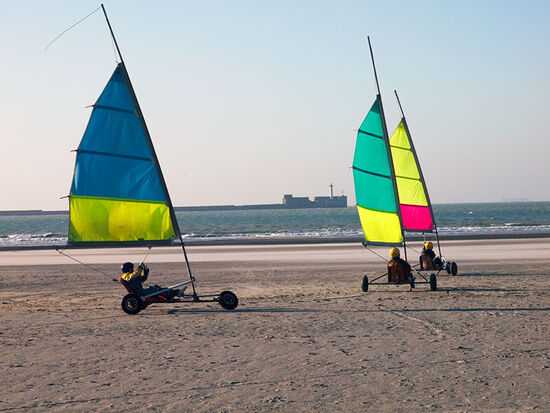 Beach sailing in Boulogne (France) with the harbour wall in the distance (photo © hidden europe).